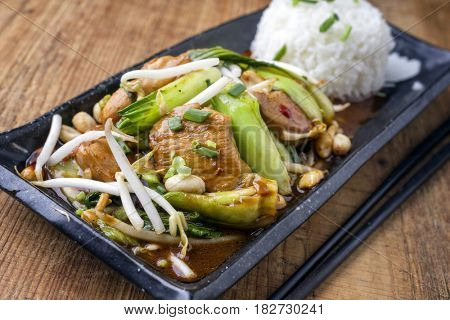 Traditional Chicken Gung Bao with Vegetable as close-up on a plate
