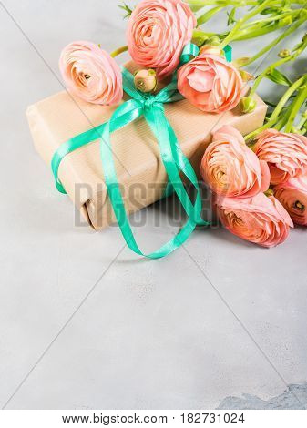 Pink Ranunculus Flowers And Gift Box