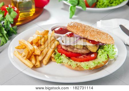 Tasty Burger Set - Meat Burger, French Fries And Sause On The White Round Plate On The Served Table