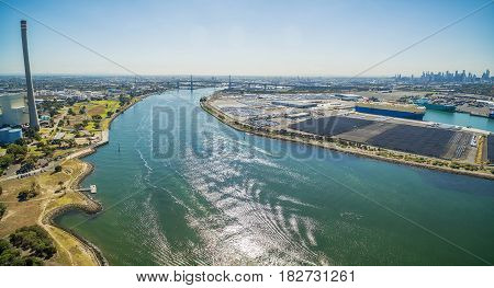 Aerial Panoramic View Of Newport Power Station, West Gate Bridge, Yarra River, And Large Car Carrier
