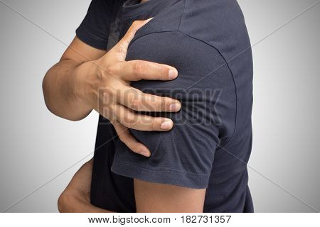 Closeup of young shirtless man with shoulder pain Upper arm pain People with muscles problem Healthcare And Medicine concept