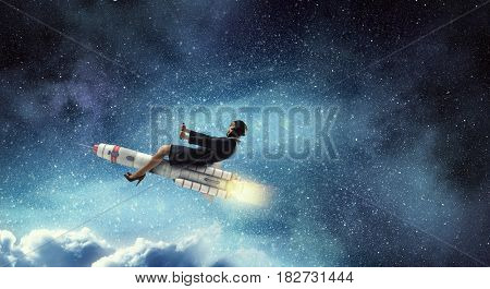 Woman riding missile. Mixed media .