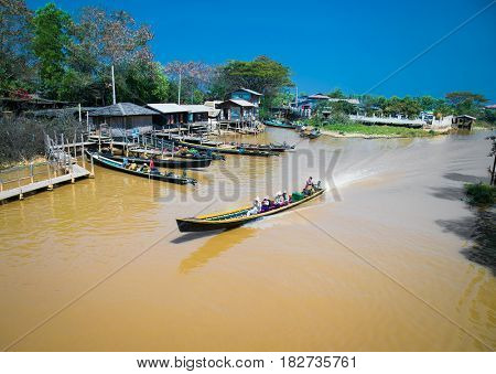 NYAUNGSHWE, MYANMAR- MARCH 4, 2017:Taxi boat transport at the Inle Lake near Nyaungshwe village on March 4, 2017, Myanmar. (Burma)