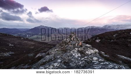 Morning hill summit Cairn in the Highlands