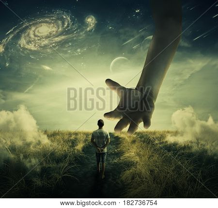 Wandering boy walks on a strange planet pathway and a giant hand descend from the skies try to catch him. Prisoner capturation manipulation concept and control as a marionette.