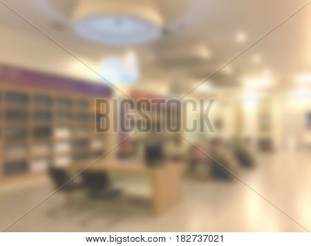 Blurred abstract background of shopping malllibrarytile shop seating for negotiate with customer