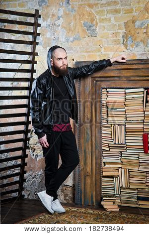 Bearded Guy In The Background Of Books