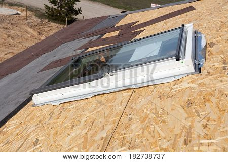 Installation of new plastic (mansard) or skylight window on a asphalt shingle roof