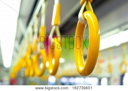 Yellow Handrail Holding Bar Inside Of Subway