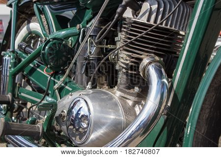 Retro motorcycle engine close-up of German carburetor
