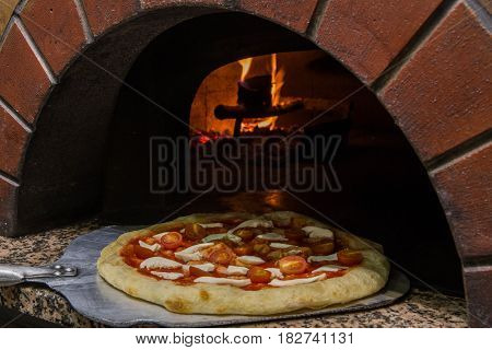 The real Russian furnace for baking of any pizza. Pizza on a big shovel