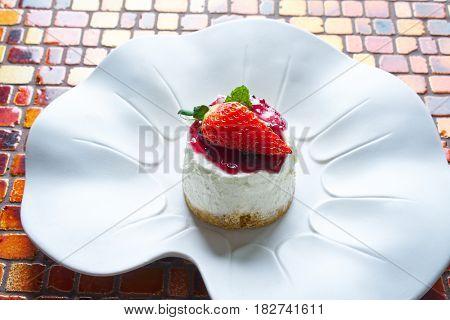 Cheesecake with cranberries sauce dessert