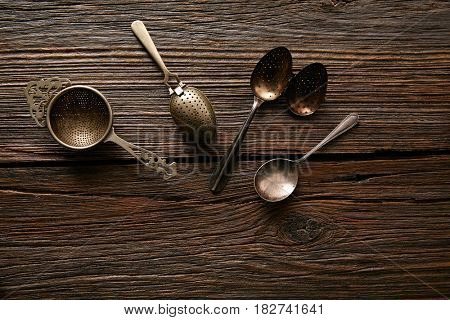 Vintage retro tea Strainers silver brass on wooden background
