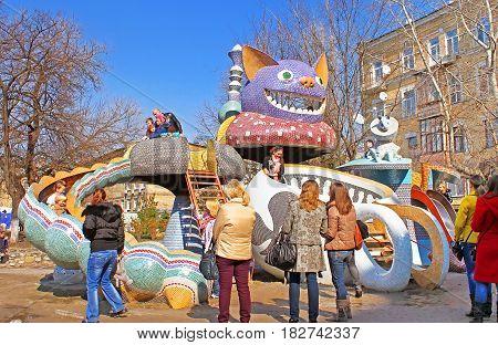 KYIV, UKRAINE - MARCH 18, 2012: Unidentified people on children's Alice in Wonderland playground in Picturesque Alley by sculptor Konstantin Skretutskiy