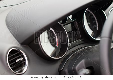 Instrument panel with a combination of indicators and the rudder steering wheel of a modern car