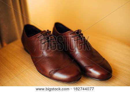 Men's black shoes on the floor. Wedding in Montenegro