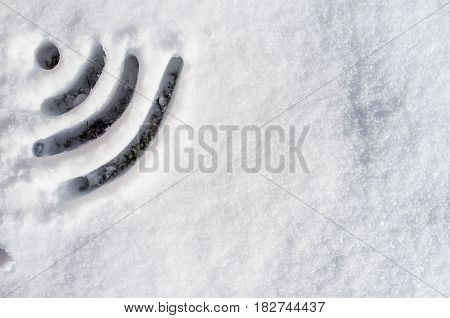Wi Fi sign drawn in the snow on a sunny day