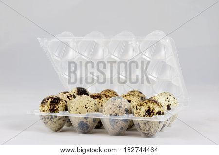 Quail Eggs On A White Isolated Background In A Mold