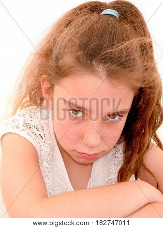 Portrait Of A Young Girl With Curly Hair All Sad And Unhappy