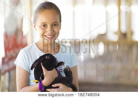 Happy Girl Playing With Rabbit