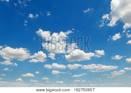 A blue sky and white cumulus clouds