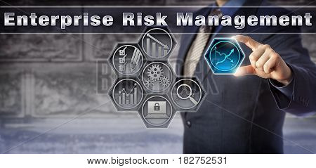 Blue chip corporate executive analyzing progress via a virtual Enterprise Risk Management monitoring matrix. Business concept for ERM auditing information technology audit and internal control.