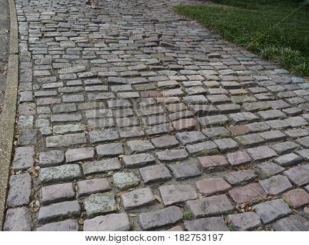 Cobblestone street Streets paved with cobblestones make several places retain their rustic, quaint appearance.