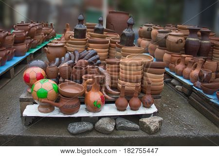 Handmade clay pots jars drinking horn. Ceramic ware with jugs plates and cups