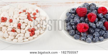 Pills Or Berries. Choice From Sources Of Vitamins.