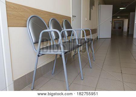 Photo of row chairs in empty corridor