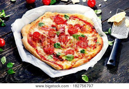 Italian Pizza  On A Dark Wooden Board.