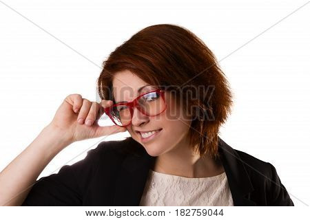 Young beautiful woman with facial expression of surprise standing over white background, wearing red glasses.