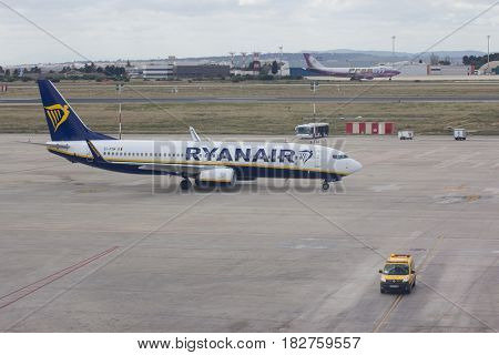 VALENCIA, SPAIN - APRIL 21, 2017: A Ryanair aircraft taxing to the gate. In 2016, Ryanair was the largest European airline by scheduled passengers carried.