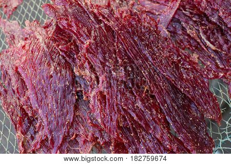 Close up texture of seasoning sun dried beef using local procedure of food preservation in Thailand.