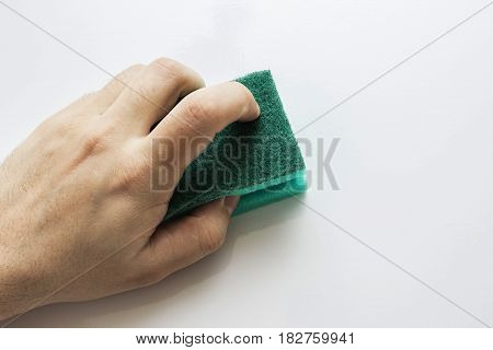 Man's hand wipes a surface. wet cleaning