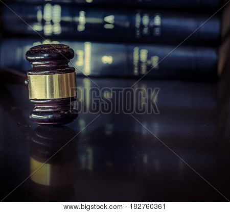 Legal law concept image, gavel on table with books behind