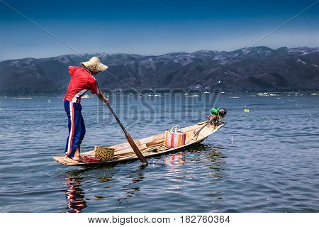 INLE , MYANMAR-MARCH 4, 2017: Traditional Burmese fisherman  catchesfish at Inle lake on March 4, 2017,  Myanmar. (Burma)