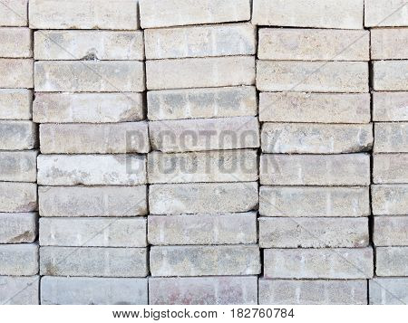 Light gray concrete pavement tiles with a rough surface complicated by each other