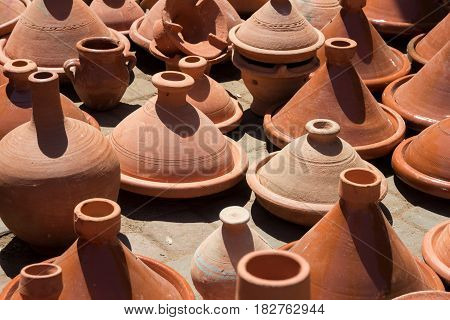 Traditional pottery being sold in a souk in the Medina of Marrakech Morocco