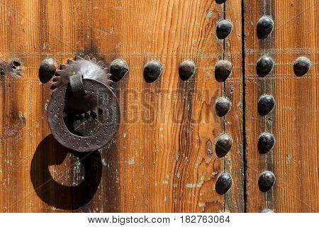 Old iron door knocker on a wooden door in Marrakesh Morocco