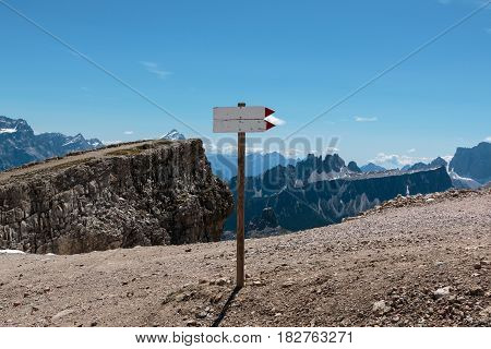 Wooden Direction Path Sign in Barren Rocky Mountain