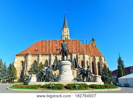 Cluj Napoca city Romania Statue of Matei Corvin and Saint Michael Church