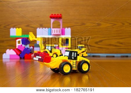 Toy Bulldozer With Bricks