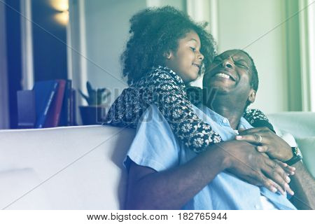 Lovely african family daughter hug her father