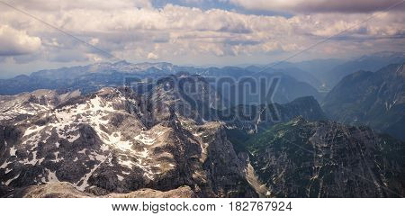 Alps, mountain tops covered with snow blue cloudy sky