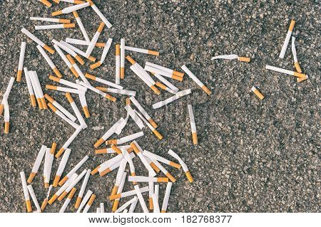 Top view of a pile of cigarettes on the ground