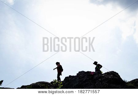 Two People Standing On the Mountain top