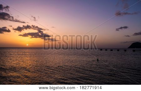 Dominica Island Sunset over Caribbean Sea at evening