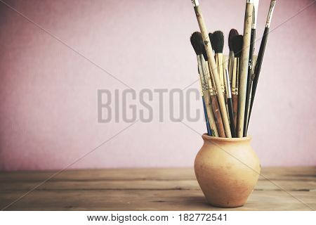 painting brushes on the wooden table background
