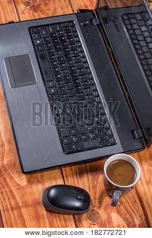 Sideview Lap Tip Computer With Wireless Mouse And Cup Of Coffee